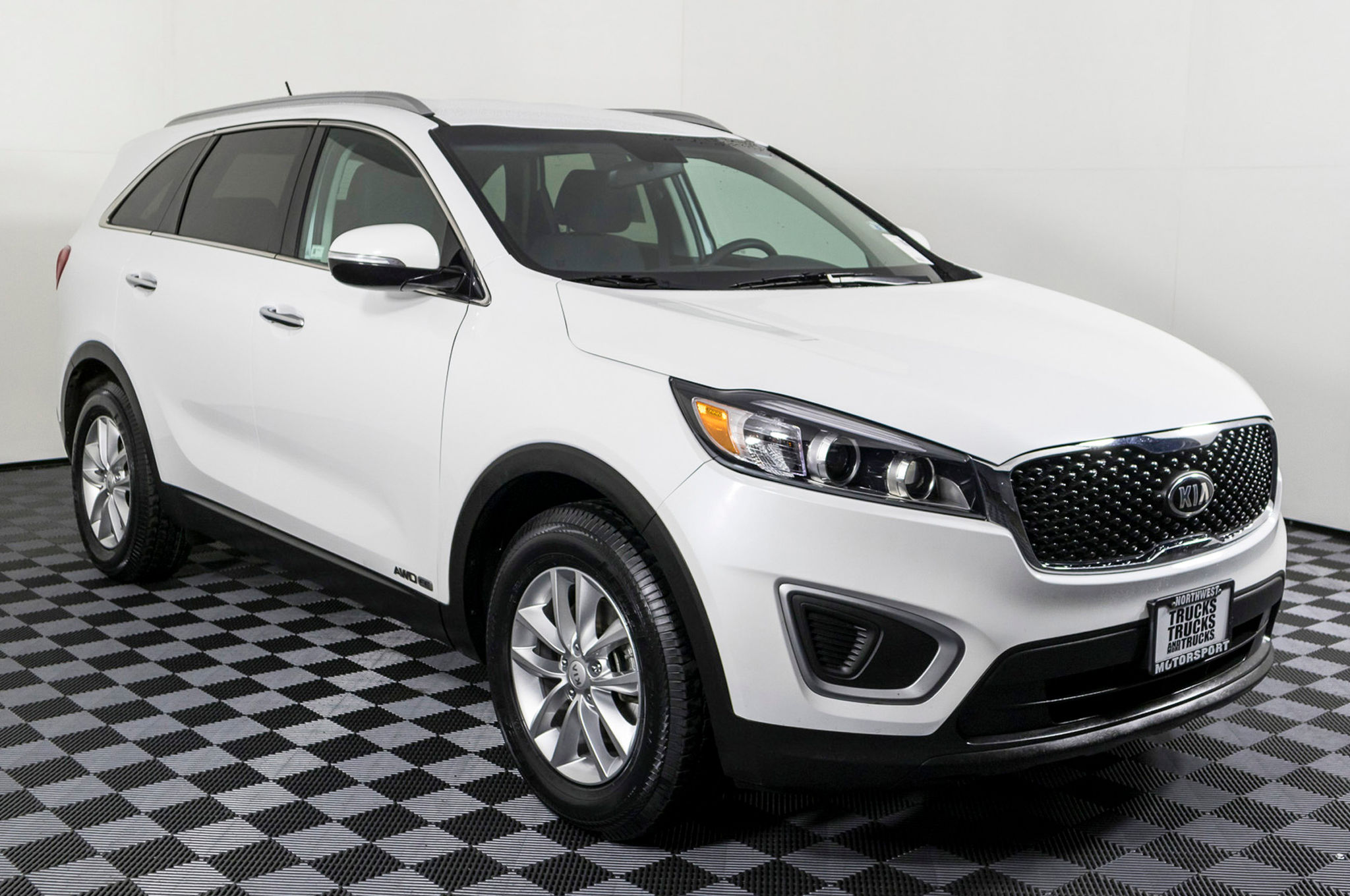 term review long in awd verdict suv three cars motion ex kia sportage front quarter