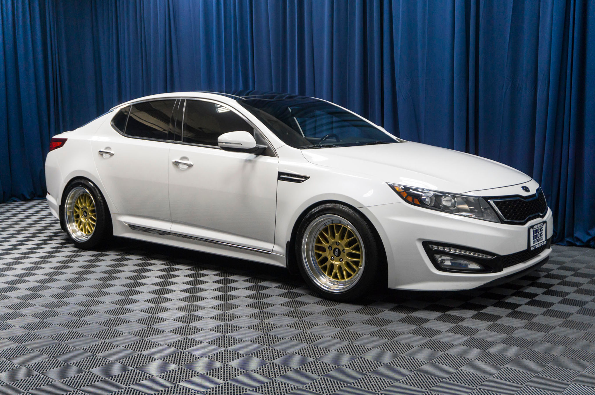 article the sxl luxurious notes kia review of sx reviews autoweek optima trim car is on market most